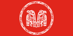 red with a white raven and eagle emblem
