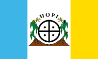 turquoise-white-yellow bands with a thick middle stripe containing a solar cross emblem