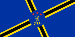 2019 Martinique flag proposal: blue with a skewed black cross outlined in yellow with a fire emblem